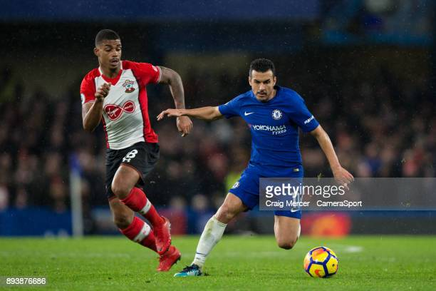 Chelsea's Pedro holds off the challenge from Southampton's Mario Lemina during the Premier League match between Chelsea and Southampton at Stamford...