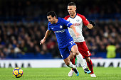 chelseas pedro protects ball from west
