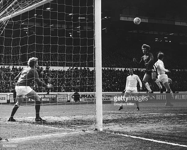 Chelsea's Peter Osgood beats Norman Hunter of Leeds United and heads the ball from a freekick during a match at at Stamford Bridge London 27th March...