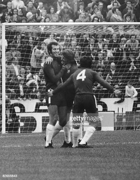Chelsea's Peter Osgood is congratulated by teammates Charlie Cooke and John Hollins after Osgood laid on a goal scored by Tommy Baldwin during a...