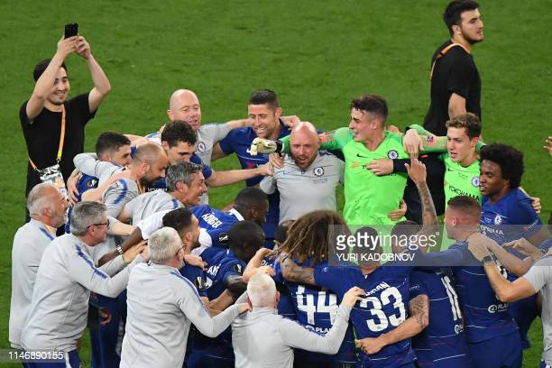 Chelsea's players celebrate after the final whistle of the UEFA Europa League final football match between Chelsea FC and Arsenal FC at the Baku...