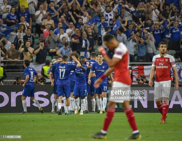 Chelsea's players celebrate scoring the 30 goal from the penalty spot during the UEFA Europa League final football match between Chelsea FC and...