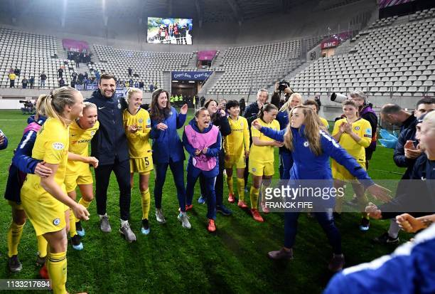 Chelsea's players celebrate their qualification for the next round after the UEFA Women's Champions League quarter final second Leg football match...