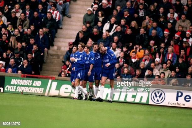 Chelsea's players celebrate Tore Andre Flo's first goal