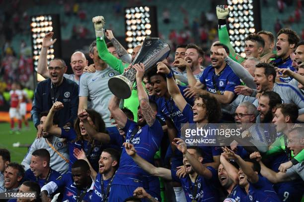 Chelsea's players celebrate with the trophy after winning the UEFA Europa League final football match between Chelsea FC and Arsenal FC at the Baku...