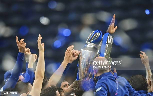 Chelsea's players celebrate with the trophy after winning the UEFA Champions League final football match between Manchester City and Chelsea FC at...