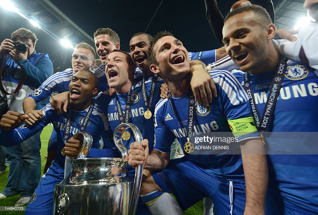 Chelsea's players pose with the trophy after the UEFA Champions League final football match between FC Bayern Muenchen and Chelsea FC on May 19, 2012 at the Fussball Arena stadium in Munich. Chelsea won 4-3 in the penalty phase.