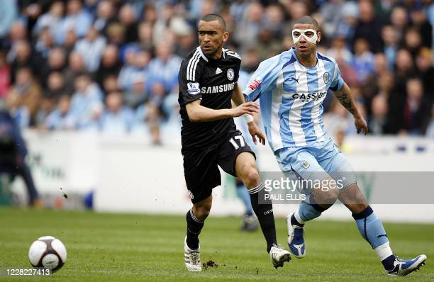 Chelsea's Portugese defender Jose Bosingwa defends against Coventry City's Irish forward Leon Best during their English FA Cup sixth round football...