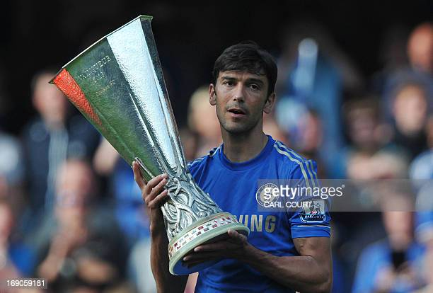 Chelsea's Portugese defender Paulo Ferreira holds the UEFA Europa League trophy at the end of the English Premier League football match between...