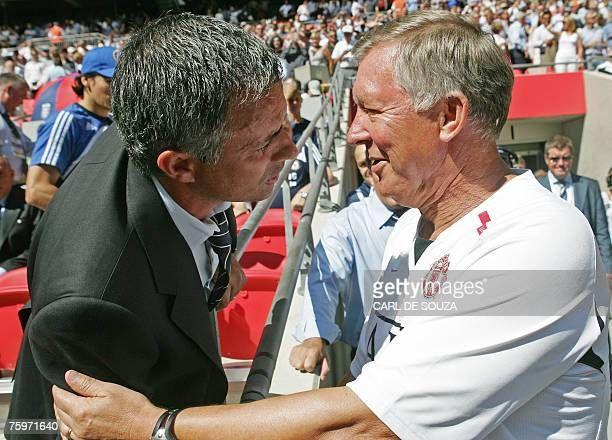 Chelsea's Portugese Manager Jose Mourinho and Manchester United's Manager Sir Alex Ferguson greet each other before their FA Community Shield match...