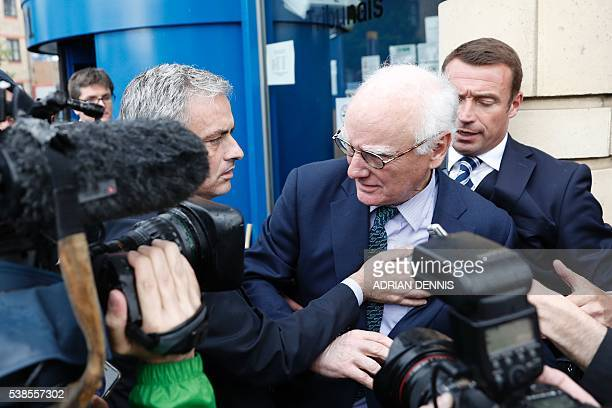 Chelsea's Portuguese former manager and Manchester United manager Jose Mourinho reaches out a hand to help steady Chelsea's US chairman Bruce Buck...