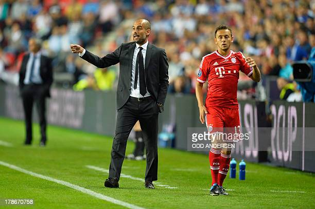 Chelsea's Portuguese manager Jose Mourinho Bayern Munich's Spanish head coach Pep Guardiola and Bayern Munich's Brazilian defender Rafinha stand on...