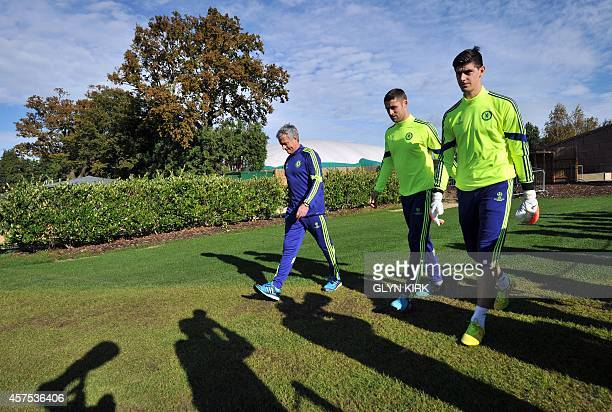 Chelsea's Portuguese manager Jose Mourinho English defender Gary Cahill and Belgian goalkeeper Thibaut Courtois attend a training session at...