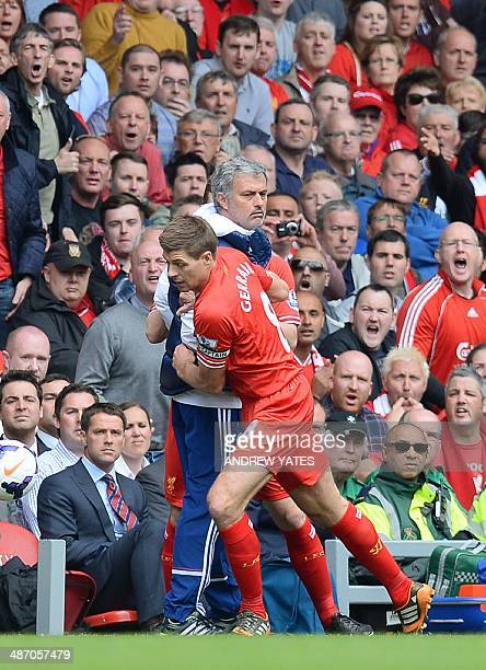 Chelsea's Portuguese manager Jose Mourinho fights for the ball with Liverpool's English midfielder Steven Gerrard during the English Premier League...