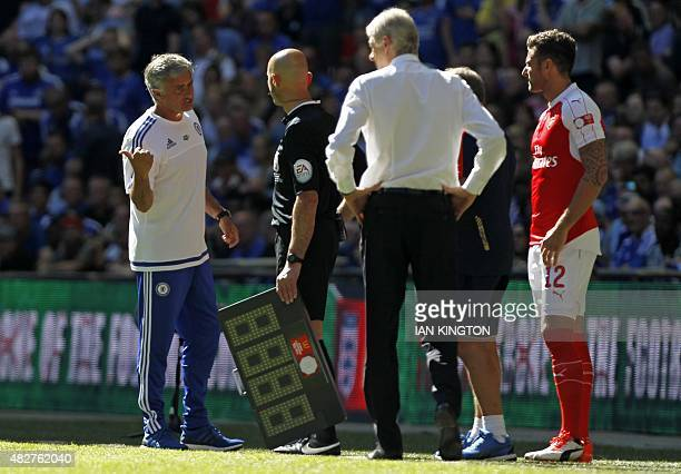Chelsea's Portuguese manager Jose Mourinho gestures as Arsenal's French manager Arsene Wenger looks on during the FA Community Shield football match...
