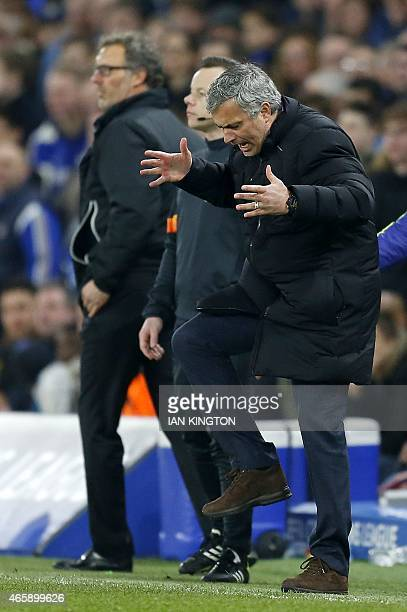 Chelsea's Portuguese manager Jose Mourinho reacts during the UEFA Champions League round of 16 second leg football match between Chelsea and Paris...