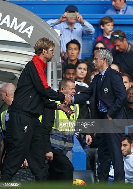 Chelsea's Portuguese manager Jose Mourinho shakes hands with Liverpool's German manager Jurgen Klopp after the English Premier League football match...