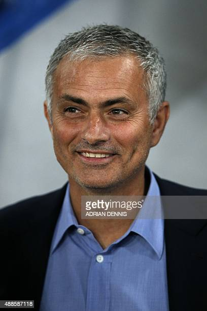 Chelsea's Portuguese manager Jose Mourinho smiles as he alks on the pitch ahead of the UEFA Champions League group G football match between Chelsea...