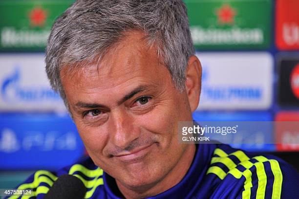 Chelsea's Portuguese manager Jose Mourinho smiles during a press conference at Chelsea's training ground in the village of Stoke D'Abernon south of...