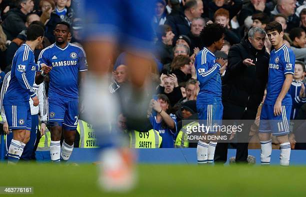 Chelsea's Portuguese manager Jose Mourinho talks with Chelsea's Brazilian midfielder Oscar and Chelsea's Brazilian midfielder Willian after the...
