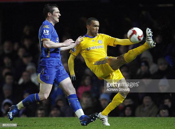 Chelsea's Portuguese player Jose Bosingwa clears the ball over Portsmouth's David Nugent during the Premiership football match at Fratton Park in...