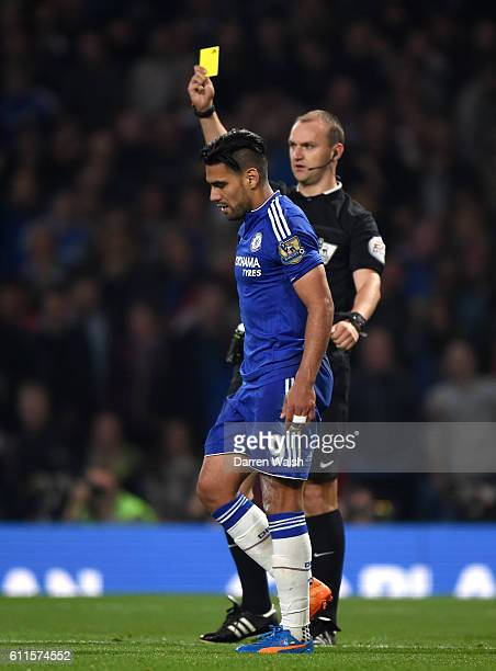 Chelsea's Radamel Falcao goes down under the challenge by Southampton goalkeeper Maarten Stekelenburg but is booked for diving by referee Robert...