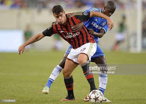 Chelsea's Ramires and AC Milan's Andrea Petagna vie for the ball during a 2013 International Champions Cup match at MetLife stadium in East...