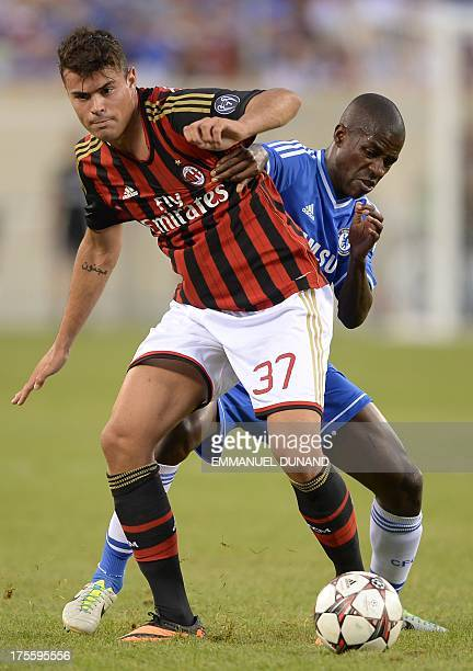 Chelsea's Ramires and AC Milan's Andrea Petagna vie for the ball during a 2013 International Champions Cup match between Chelsea and AC Milan at...