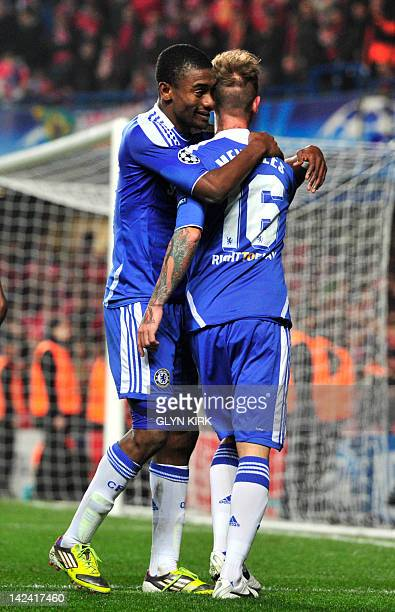 Chelsea's Raul Meireles celebrates scoring with his John Obi Mikel against Benfica during their UEFA Champions League quarter finals football match...