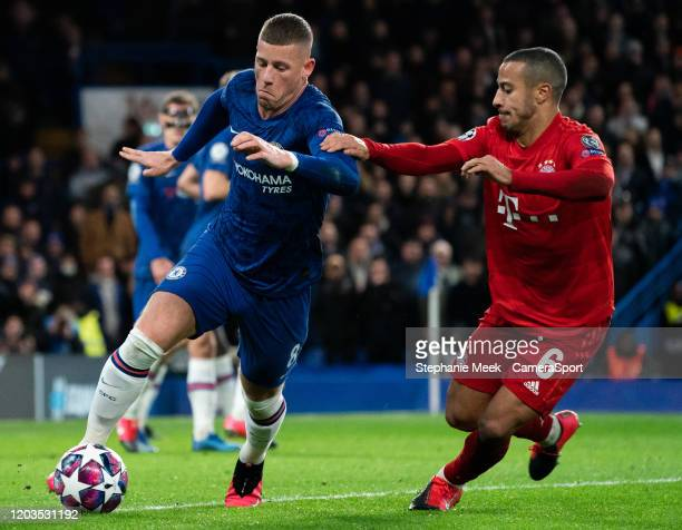 Chelsea's Ross Barkley shields the ball from Bayern Munich's Thiago during the UEFA Champions League round of 16 first leg match between Chelsea FC...