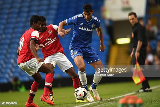 Chelsea's Ruben LoftusCheek and Arsenal's Ainsley MaitlandNiles Gedion Zelalem during a FA Youth Cup Semi Final 1st Leg match between Chelsea U18 and...