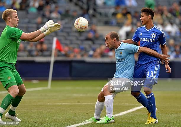 Chelsea's Ruben LoftusCheek in action with Manchester City's Pablo Zabaleta and Joe Hart