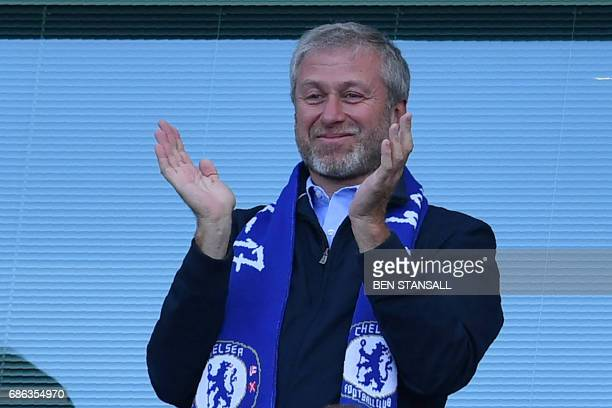 Chelsea's Russian owner Roman Abramovich applauds as players celebrate their league title win at the end of the Premier League football match between...