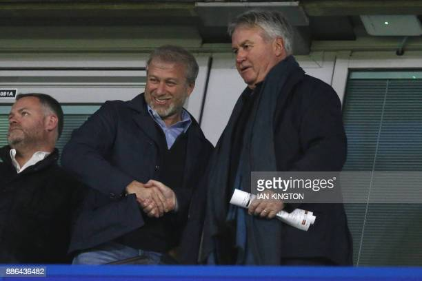 Chelsea's Russian owner Roman Abramovich shakes hands with former Chelsea manager Guus Hiddink during a UEFA Champions League Group C football match...