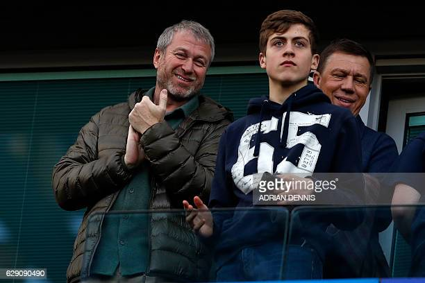 Chelsea's Russian owner Roman Abramovich smiles as he awaits kickoff in the English Premier League football match between Chelsea and West Bromwich...