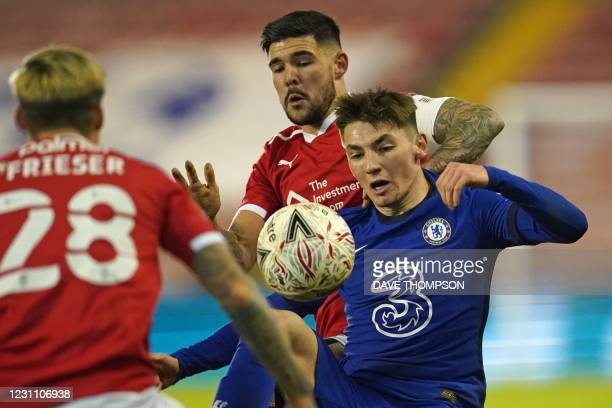 Chelsea's Scottish midfielder Billy Gilmour vies with Barnsley's English midfielder Alex Mowatt during the English FA Cup fifth round football match...