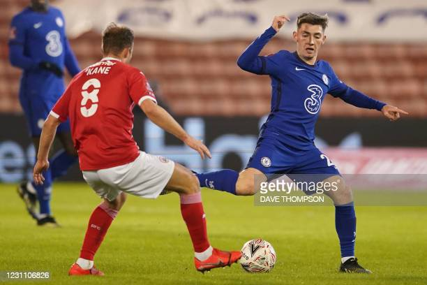 Chelsea's Scottish midfielder Billy Gilmour vies with Barnsley's English midfielder Herbie Kane during the English FA Cup fifth round football match...