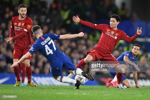 Chelsea's Scottish midfielder Billy Gilmour vies with Liverpool's Japanese midfielder Takumi Minamino during the English FA Cup fifth round football...