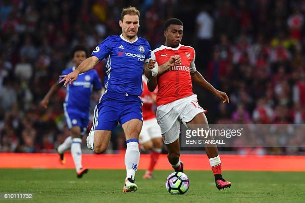 Chelsea's Serbian defender Branislav Ivanovic and Arsenal's Nigerian striker Alex Iwobi chase the ball during the English Premier League football...
