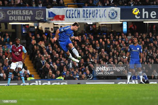 Chelsea's Serbian defender Branislav Ivanovic heads the ball clear during the English Premier League football match between Chelsea and Aston Villa...