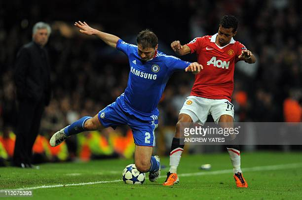 Chelsea's Serbian defender Branislav Ivanovic is tackled by Manchester United's Portuguese midfielder Nani during the UEFA Champions League quarter...