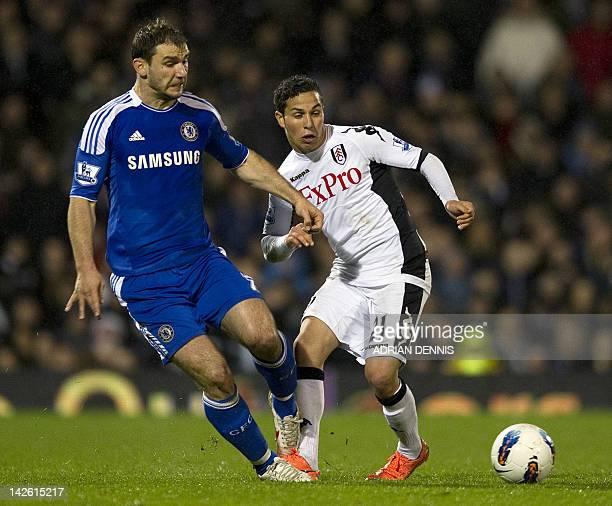Chelsea's Serbian defender Branislav Ivanovic vies with Fulham's AustrianSwiss midfielder Kerim Frei during the English Premier League football match...