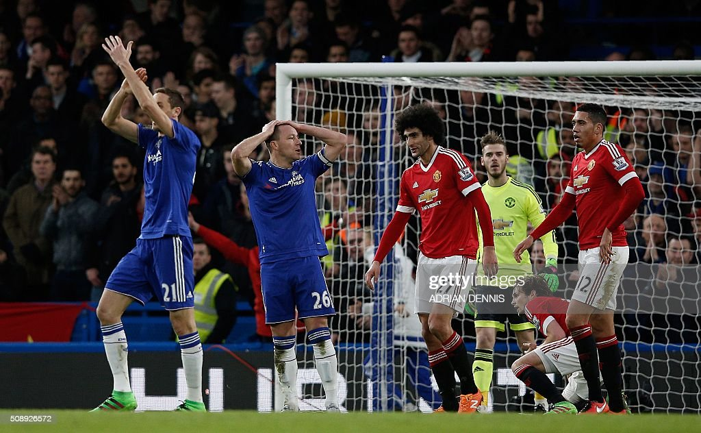 Chelsea's Serbian midfielder Nemanja Matic (L) and Chelsea's English defender John Terry claim a penalty after Terry's shot was blocked by Manchester United's Dutch midfielder Daley Blind during the English Premier League football match between Chelsea and Manchester United at Stamford Bridge in London on February 7, 2016. / AFP / ADRIAN DENNIS / RESTRICTED TO EDITORIAL USE. No use with unauthorized audio, video, data, fixture lists, club/league logos or 'live' services. Online in-match use limited to 75 images, no video emulation. No use in betting, games or single club/league/player publications. /
