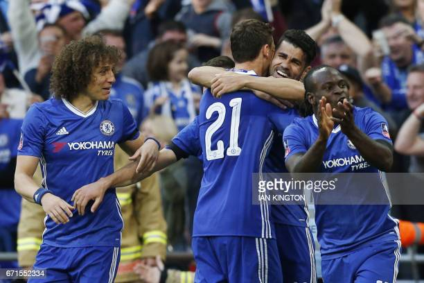 Chelsea's Serbian midfielder Nemanja Matic celebrates scoring Chelsea's fourth goal with teammates during the FA Cup semifinal football match between...