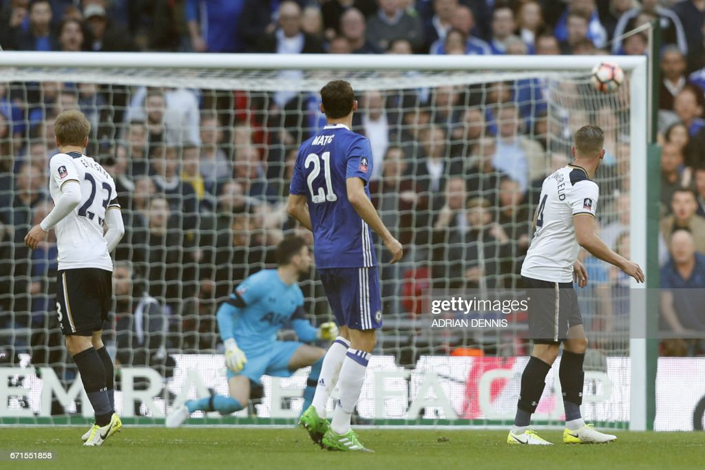 Chelsea's Serbian midfielder Nemanja Matic (C) scores Chelsea's fourth goal during the FA Cup semi-final football match between Tottenham Hotspur and Chelsea at Wembley stadium in London on April 22, 2017. / AFP PHOTO / Adrian DENNIS / NOT
