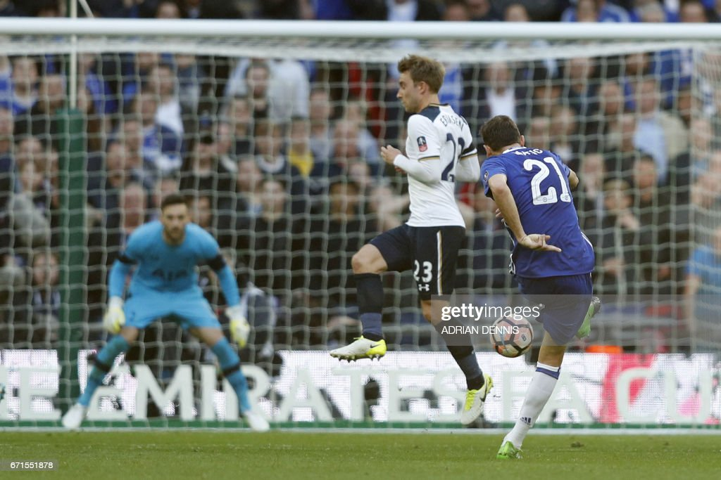 Chelsea's Serbian midfielder Nemanja Matic (R) scores Chelsea's fourth goal during the FA Cup semi-final football match between Tottenham Hotspur and Chelsea at Wembley stadium in London on April 22, 2017. / AFP PHOTO / Adrian DENNIS / NOT