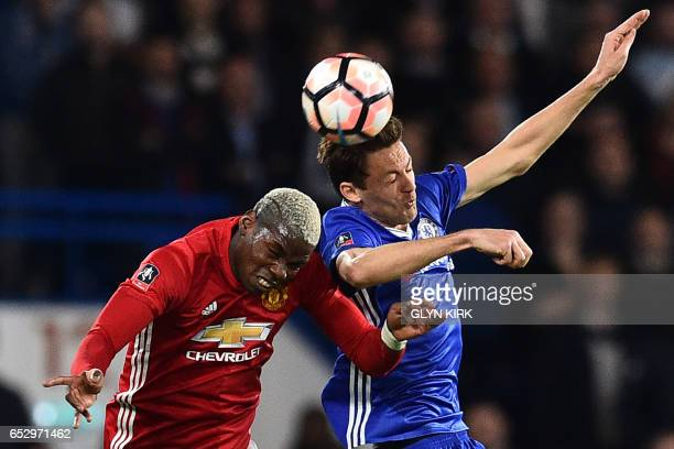 TOPSHOT Chelsea's Serbian midfielder Nemanja Matic vies with Manchester United's French midfielder Paul Pogba during the English FA Cup quarter final...