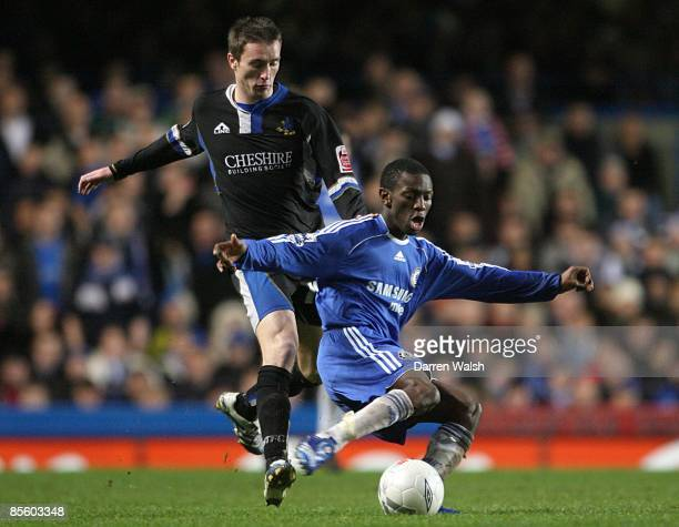 Chelsea's Shaun WrightPhillips is challenged by Macclesfield Town's Kevin McIntyre as they battle for the ball