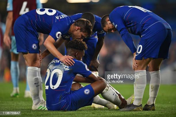 TOPSHOT Chelsea's Spanish defender Cesar Azpilicueta and Chelsea's Belgian midfielder Eden Hazard console an injured Chelsea's English midfielder...