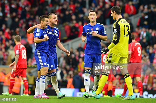Chelsea's Spanish defender Cesar Azpilicueta and Chelsea's English defender John Terry celebrate their victory with Chelsea's Belgian goalkeeper...